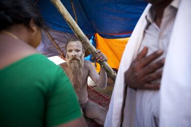 India, Uttar Pradesh, Varanasi, Sadhu sitting in tent - JBA000056