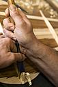 Guitar maker in his workshop, close-up - TC003864