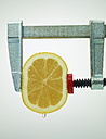 Squeezing half of a lemon with bar clamp - AKF000310