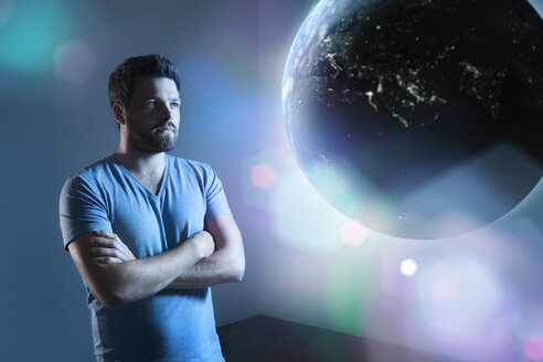 Serious looking man watching earth - PD000624
