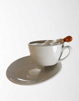 White coffee cup with white coffee and saucer falling in front of white background - AKF000301