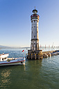 Germany, Bavaria, Lindau, View of light house with excursion boat in lake - WD002246