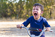USA, Texas, Despaired boy on bike - ABAF001206