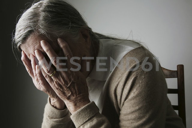 Senior woman covering face with her hands - JATF000651