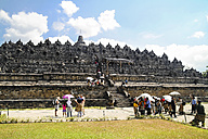 Indonesia, Java, Yogyakarta, Tourists at Borobudur Temple - KRP000275