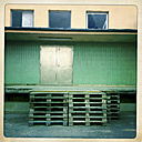 Stacked pallets in front of warehouse, Horn, Lower Austria, Austria - DISF000529