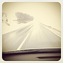 View from the car on wet pavement, snow, winter, Lower Austria, Austria - DISF000536