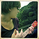 Teenager playing on ukulele, sings, Lower Austria, Austria - DISF000554