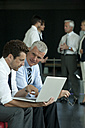 Two businessmen with laptop - CHAF000068