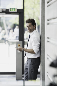 Businessman with cell phone - CHAF000061