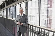 Senior businessman using cell phone - CHAF000088