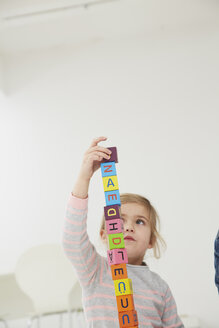 Germany, Munich , Girl playing with wooden blocks - FSF000138