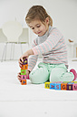 Germany, Munich , Girl playing with wooden blocks - FSF000135