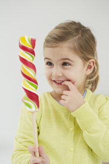 Germany, Girl with lolly pop - FSF000119