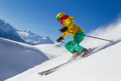Switzerland, Graubuenden, Obersaxen, female Skier - EGF000099