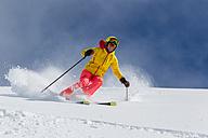 Switzerland, Graubuenden, Obersaxen, female Skier - EGF000028