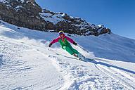 Switzerland, Graubuenden, Obersaxen, female Skier - EGF000034