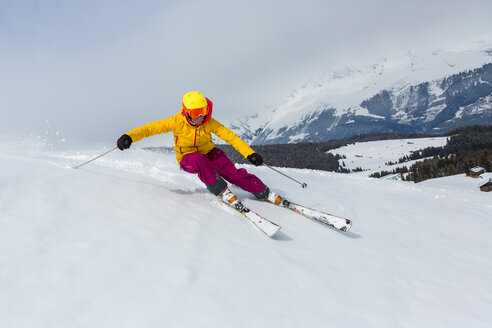 Switzerland, Graubuenden, Obersaxen, female Skier - EGF000040
