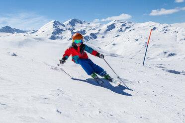 Switzerland, Grisons, Obersaxen, Boy skiing - EGF000056
