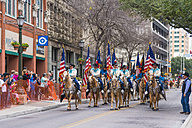 USA, Texas, San Antonio, Grand opening parade of the 2014 Rodeo, Riders with American flags on horseback - ABA001237