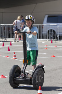 Germany, Bavaria, Boy riding segway - EG000095