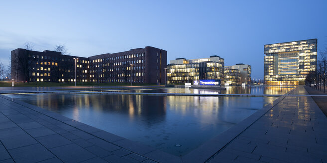 Germany, North Rhine-Westphalia, Essen, Krupp-Guertel, lighted headquarter of ThyssenKrupp at evening twilight - WI000361