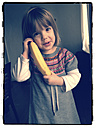 Little girl with banana as a telephone - LVF000623