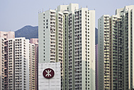 China, Hongkong, Lantau Island, Tung Chung, high rise residential buildings with metro station in front - GW002560