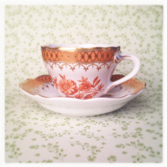 Tea Cup on Green Floral Background, - MVC000115