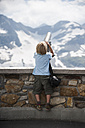 Austria, Grossglockner, Young boy watching through a binocular - PAF000397