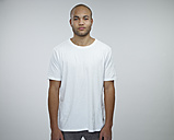 Portrait of young African man wearing white t-shirt - RH000325