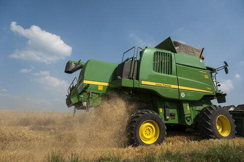 Germany, Rhineland-Palatinate, Rhineland-Palatinate, Combine harvester on barley field - PA000406