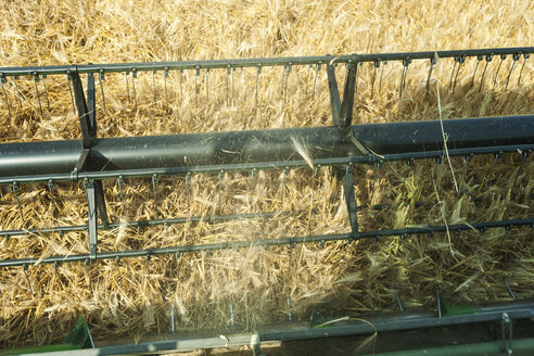 Germany, Rhineland-Palatinate, Rhineland-Palatinate, Combine harvester on barley field - PA000401