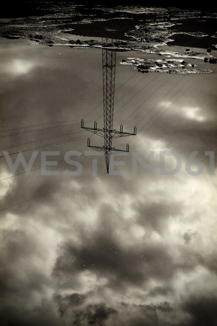 Power pylon reflecting in water surface - HOHF000482 - Fotomaschinist/Westend61
