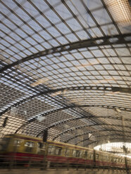 Germany, Berlin, driving suburban train at central station - LA000545