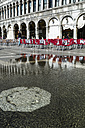 Italy, Venice, St Mark's Square, Water flowing through manhole cover - EJW000271