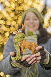 Young woman holding miniature deer with scarf - CLPF000067