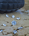 Diamonds on soil with hand grenade in background - AK000325