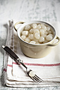 Pickled silverskin onions in a bowl and on fork - SBDF000598