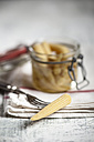 Pickled baby corn in preserving jar and fork - SBDF000616