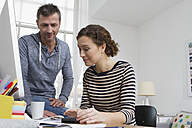 Man and woman at home sitting at desk with bills - RBYF000367