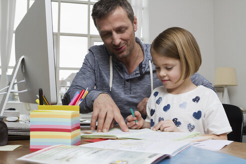 Father with daughter at desk drawing - RBYF000395