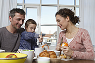 Father, mother and son having healthy breakfast - RBYF000445