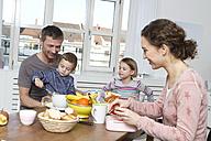 Family of four having healthy breakfast - RBYF000448