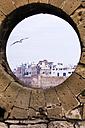 Morocco, Essaouira, Kasbah, cityscape behind round window - THAF000110
