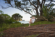 New Zealand, North Island, Waikato, Coromandel Peninsula, Hahei Beach, girl on swing - JB000020