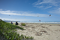 New Zealand, North Island, Puawai Bay, Orewa Beach, kids watching kite surfers - JB000045