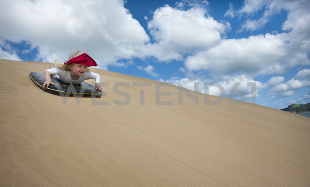 New Zealand, North Island, Northland, Hokianga Harbour, girl on sandboard - JB000056