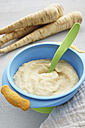 Bowl of parsnip puree, parsnips and cloth on wooden table - IPF000022