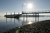Germany, Baden-Wuerttemberg, Constance District, Lake Constance, Mainau, jetty against the sun - JEDF000163